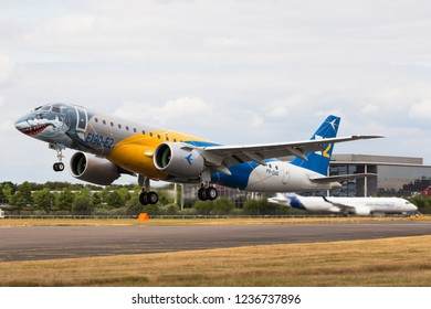 """FARNBOROUGH, ENGLAND - JULY 17, 2018: The new Embraer E190-E2 """"Profit Hunter"""" taking off during Farnborough Airshow 2018 to start it's display flight."""