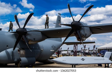 Farnborough, Hampshire, UK - July 16 2018: Hercules C130 on static display with the AGM-158, at the Farnborough air show 2018