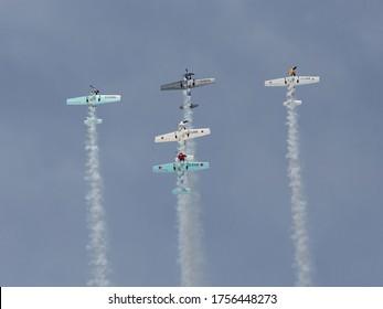 Farnborough - July 19, 2014: Aerostars aerobatic display team in YAK-50s performing aerial acrobatics