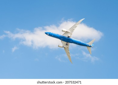 FARNBOROUGH, UK - JULY 14: The newly developed Boeing 787-9 Dreamliner in a steep banked turn before landing at Farnborough airport, UK on July 14, 2014