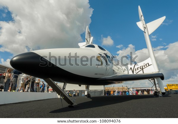 FARNBOROUGH, UK - JULY 15: The futuristic Virgin Galactic reuseable, sub-orbital spacecraft on static display at the Farnborough International Airshow, UK on July 15, 2012