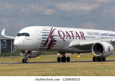 Farnborough, UK - July 16, 2014: Airbus A350-941 commercial aircraft with a hybrid Airbus/Qatar Airways livery.