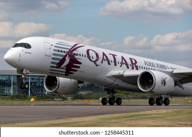 Farnborough, UK - July 18, 2014: Airbus A350-941 commercial aircraft with a hybrid Airbus/Qatar Airways livery.