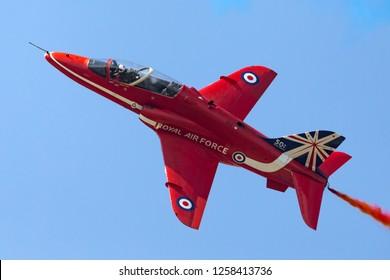 Farnborough, UK - July 20, 2014: Royal Air Force (RAF) Red Arrows formation aerobatic display team flying British Aerospace Hawk T.1 Jet trainer aircraft.