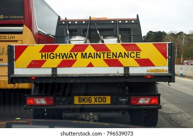 Farnborough, UK - March 28th 2017: Rear of a UK Highway Maintenance truck in a motorway traffic queue