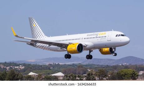 FARO AIRPORT, FARO, PORTUGAL - September 7, 2019: Vueling Airlines Airbus A320-271N (EC-NCU) landing on September 7, 2019 at Faro Airport, Faro, Portugal.