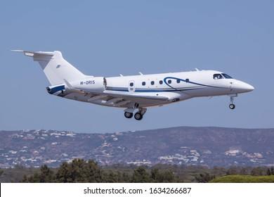 FARO AIRPORT, FARO, PORTUGAL - September 7, 2019: Embraer Legacy 500 (M-ORIS) landing on September 7, 2019 at Faro Airport, Faro, Portugal.