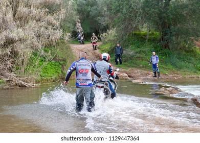Faro, Portugal, 02.27.2016. The motorbikers train to cross the mountain river.