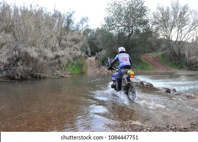 Faro, Portugal, 11.27.2015. Group of motorbikes crossing the mountain river at south part of Portugal.