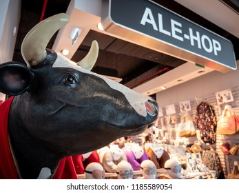 FARO, PORTUGAL - 6 AUGUST 2018: A concession store of the Ale-Hop chain of gift shops in Faro Airport, Portugal.  The cow is synonymous with the brand and prominently displayed in all Ale-Hop stores.