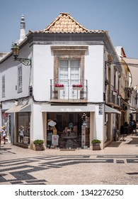 FARO, PORTUGAL - 6 AUGUST 2018: A shopfront in a traditional Portuguese style in the central pedestrianized shopping district of Faro in the Algarve region.
