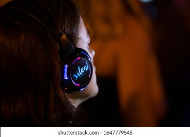 FARO, PORTUGAL: 6th SEPTEMBER, 2019 - Audience uses headphones in silent disco party concept on  Festival F, a big festival on the city of Faro, Portugal.