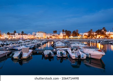 Faro - Portugal, April 1, 2018: Night view of the Old Town and the  Marina of Faro in Algarve,  Portugal.