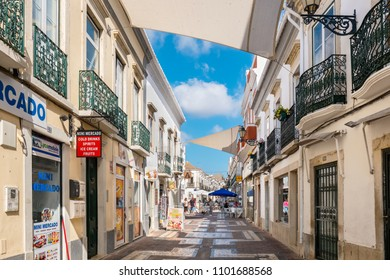FARO, PORTUGAL - AUGUST 30, 2017: Shops and street cafe on a pedestrian area in old town