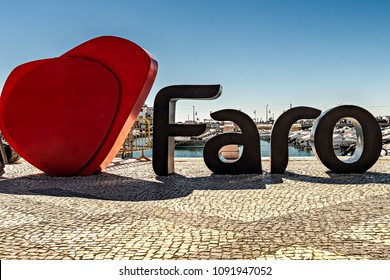 Faro, Portugal. Circa April 2018. A sign made of big letters spelling FARO welcomes tourists to the charming town of Faro in the Algarve region of Portugal.