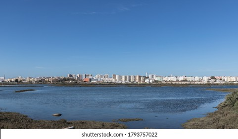 Faro, Portugal - February 26, 2020: City view from the commercial harbor by the sea on a winter day