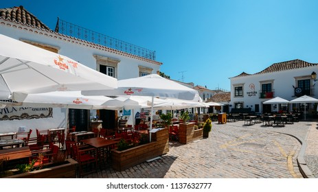 Faro, Portugal - July 16, 2018: Restaurant terrace in the historic centre of Faro, Algarve, Portugal