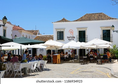 FARO, PORTUGAL - JUNE 12, 2017 - Restaurants in Afonso III Square (Praca do Afonso III) in the city centre, Faro, Algarve, Portugal, Europe, June 12, 2017.