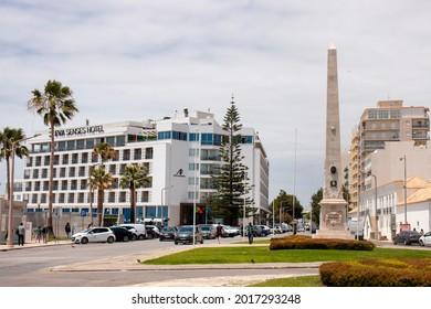 FARO, PORTUGAL - june 2021: Close view of the Ferreira d'Almeida, Obelisk and Hotel EVA, located in Faro, Algarve, Portugal.