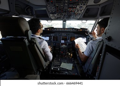 FARO, PORTUGAL - MAY 13, 2017: Pilots in the cockpit of Ryanair aircraft. Ryanair has an unblemished 32-year safety record