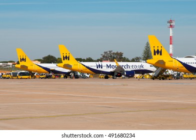 FARO/ALGARVE, PORTUGAL - SPRING 2016 3 Monarch Airbusses (A320/A321) unloading sunseeking holidaymakers at Faro Airport.