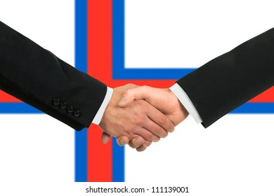 The Faroe Islands flag and business handshake