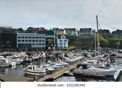 Tórshavn, Faroe Islands - May 28, 2018. Urban skyline with Torshavn Port and distant city from Tinganes with yachts and ships in foreground. Captivating Capital of the Faroe Islands on Island Streymoy