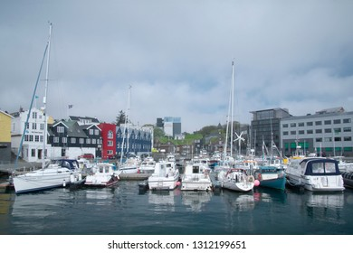 Tórshavn, Faroe Islands - May 28, 2018. Urban skyline with Torshavn Port and distant city with yachts and ships in foreground. Captivating Capital of the Faroe Islands on Island Streymoy