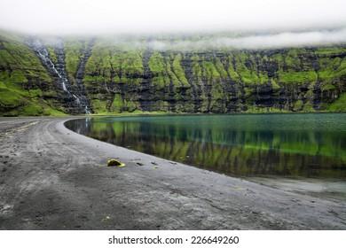 Faroe Islands - Saksun village. Small waterall, Streymoy island, Denmark