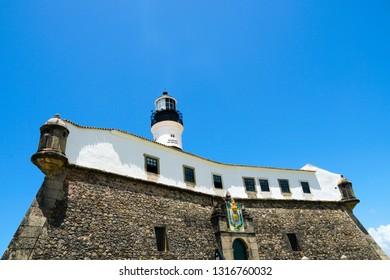Farol da Barra (Barra Lighthouse) in Salvador, Bahia, Brazil.  The historic architecture of Salvador in Bahia, the Farol da Barra Lighthouse at Bahia de Todos os Santos Bay.