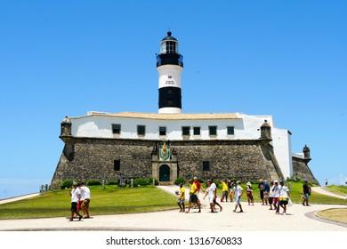 Farol da Barra (Barra Lighthouse) in Salvador, Bahia, Brazil.  The historic architecture of Salvador in Bahia, the Farol da Barra Lighthouse at Bahia de Todos os Santos Bay. 02/05/2019