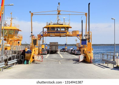 Farosund, Sweden - May 13, 2016: Public road-ferry at the berth in Farosund connecting the two islands Faro and Gotland.