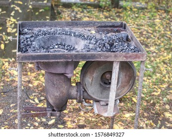 Farriers open portable furnace. Burning coal in the furnace, extinguished fire in furnace in smithy temporary work place.  Concept of backsmithing