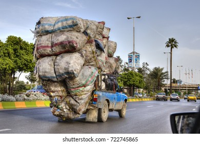 Fars Province, Shiraz, Iran - 18 april, 2017: Overloaded with sacks of household waste, the car is moving along the city road.