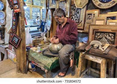 Fars Province, Shiraz, Iran - 19 april, 2017:  Art workshop in Vakil Bazaar, handyman makes a work of art.