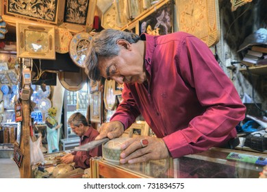 Fars Province, Shiraz, Iran - 19 april, 2017: Art workshop at the Vakil bazaar, the artist produces handiwork for sale in the shop of artistic products.