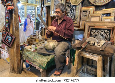 Fars Province, Shiraz, Iran - 19 april, 2017:  The art workshop inside the Vakil Bazaar, craftsman produces a work of art.