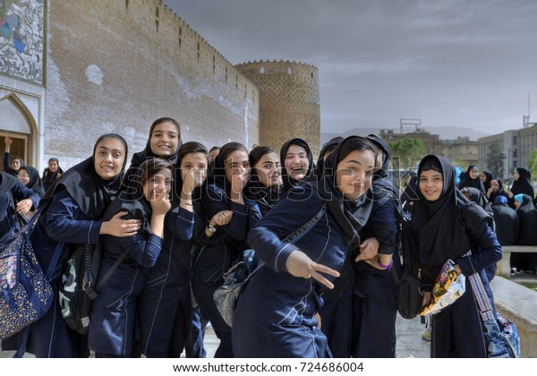 Fars Province, Shiraz, Iran - 19 april, 2017:  A group of Iranian schoolgirls having fun and posing looking into the camera lens.