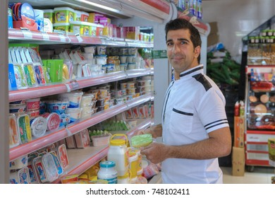 Fars Province, Shiraz, Iran - 20 april, 2017:  The buyer in the Iranian supermarket chooses food products on the shelf.