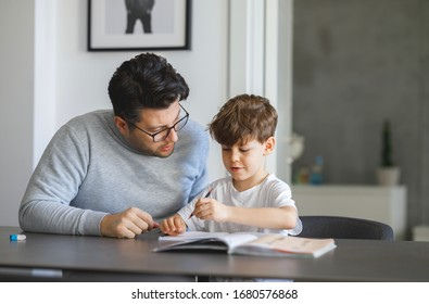 Farther Helping Son to finish his Homework
