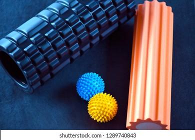 Fascia rolls and spiky massage balls on the slate
