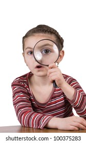 fascinated small school girl with magnifying lens looking through loupe isolated on white