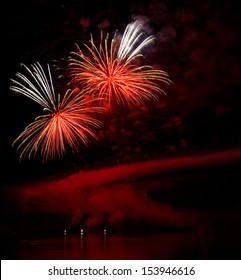 A fascinating fireworks on a lakeside