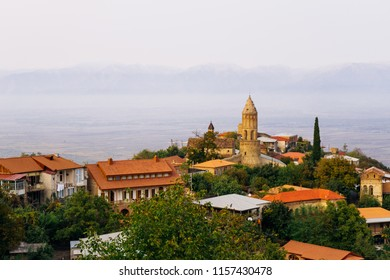 fascinating magical landscape of the city of Signagi, a lot of greenery and a calm blue sea