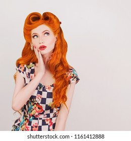 Fascinating smile on face. Beautiful stylish attire. Shock redhead woman with hairstyle isolated on gray. Fascinating girl in bright attire. Shock face and summer sale concept. Redhead model