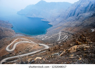 A fascinating view of the sea and the zigzag road in the Oman