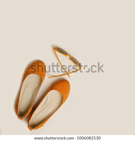 2546e61f7 ... Stock Photo (Edit Now) 1006082530 - Shutterstock. Fashion accessories  for the beach - shoes and orange glasses on a white background. Selective