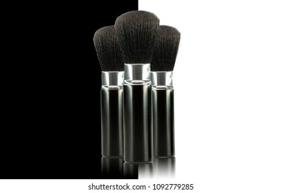 Fashion accessories, brushes isolated on black and white background, conceptual shot