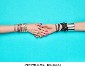 Fashion Accessories Set. Female hand, Stylish Trendy Jewelry, Glamor bracelets Ring. Minimal Design. Summer Girl Outfit. Hipster Essentials. Creative Art. Handshake Friendship concept