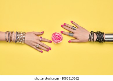 Fashion Accessories Set. Female hand, Stylish Trendy Jewelry, Glamor bracelets Ring, Flower.Minimal Design. Summer Girl Outfit.Hipster Essentials. Creative Art.Friendship fashionableconcept on Yellow